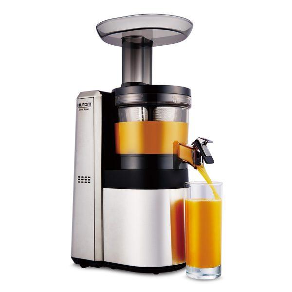 Hurom HWS slow juicer extracting juice